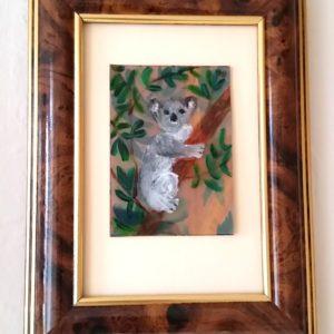 Miniature painitng with a koala hugging a tree