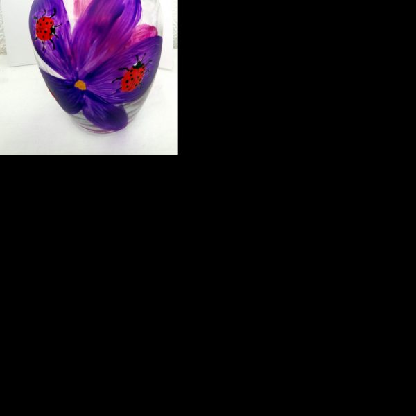 vase with ladybirds on bright purple and pink flowers