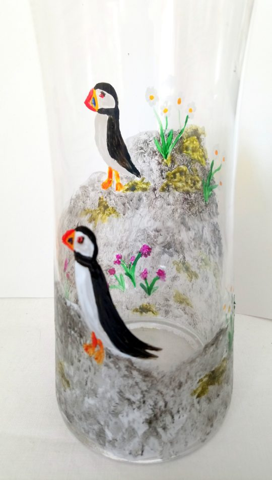 Hand painted vase with puffins on a cliff
