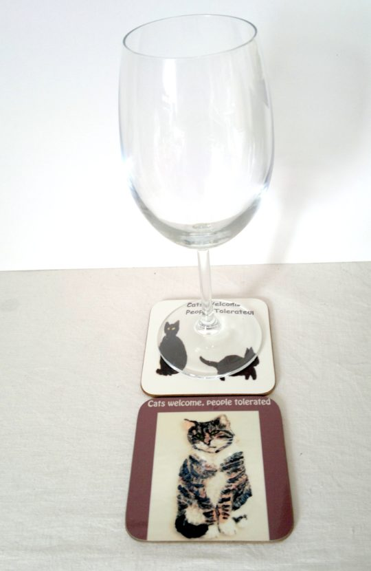Photo of cat coasters with a wine glass