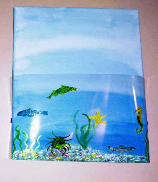 Fish, crab, starfish and seahorse glass paintings on acetate curved over a blue sea acrylic painting on canvas