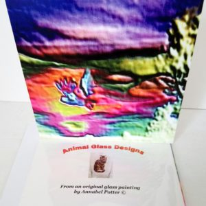Colourful greeting card with an owl in flight with a multi-coloured abstract background