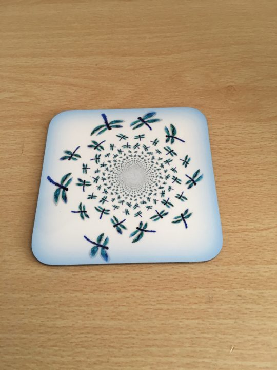 Coaster with an abstract illustration of dragonflies in a swirl