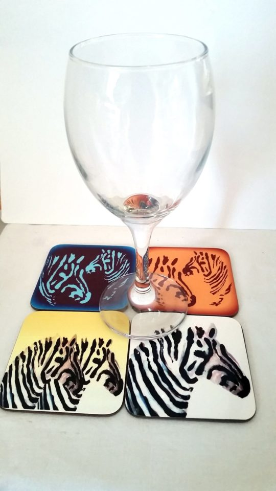 Set of 4 coasters with zebra artwork and a wine glass