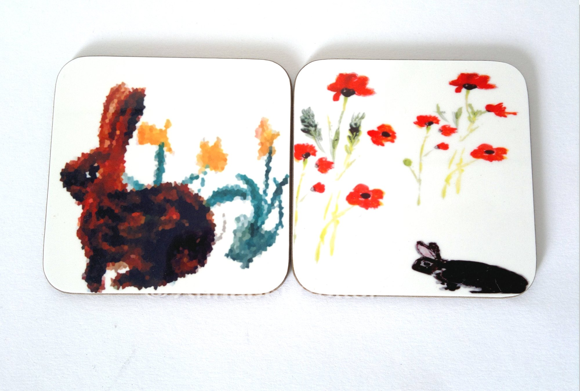 A pair of coasters with rabbits and Daffodils or Poppies