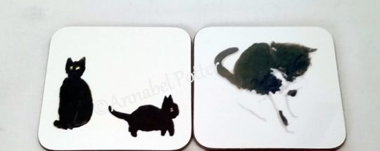 Coasters with black cats and a black and white cat