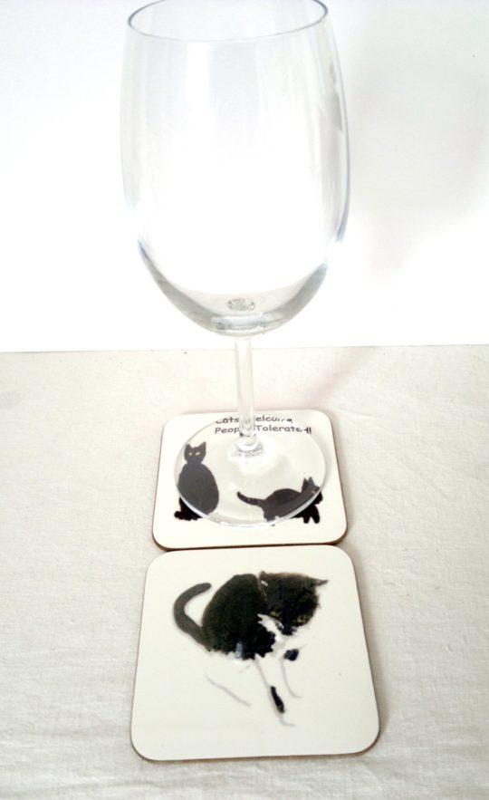 A black cat coaster set photo with wine glass