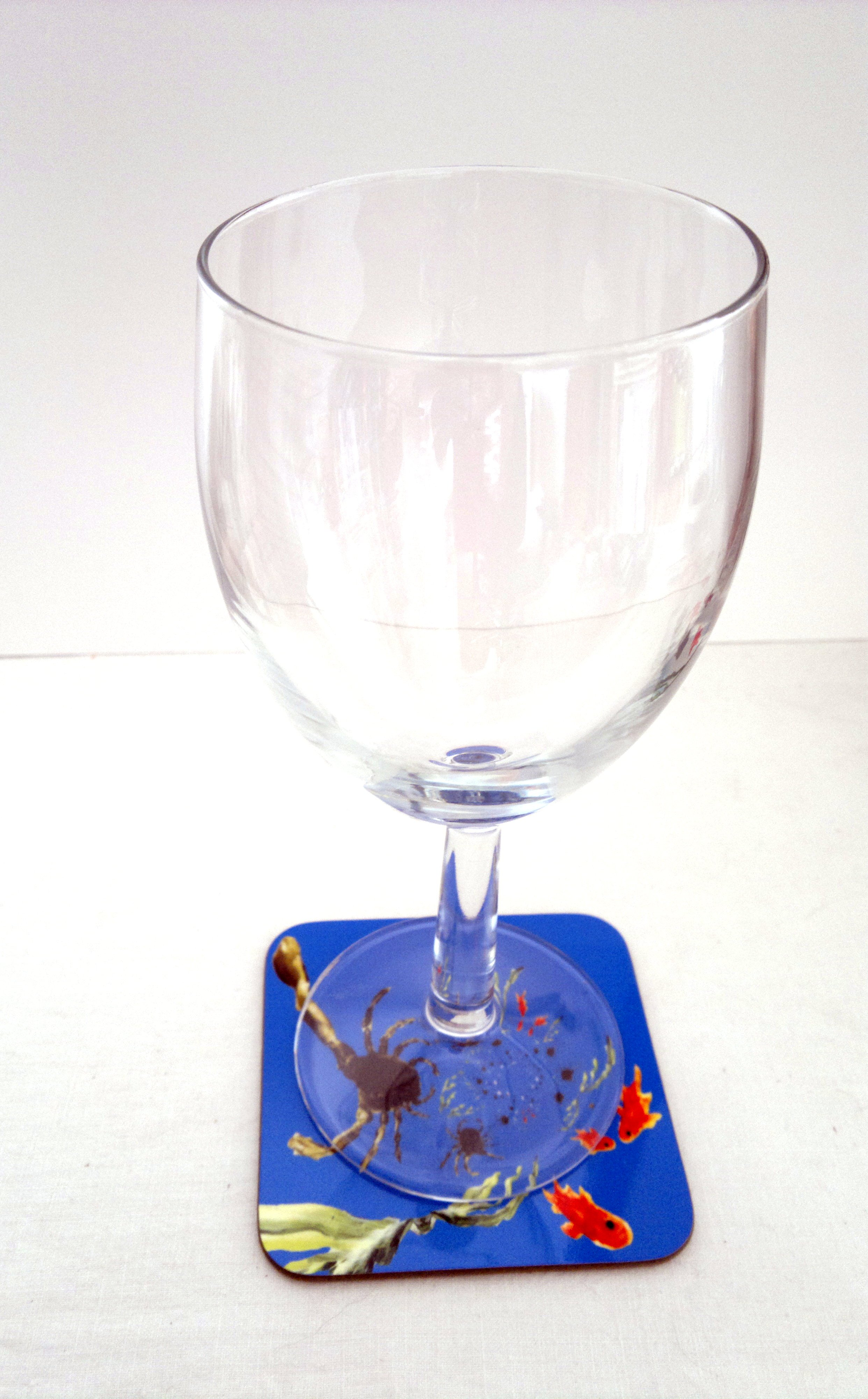 Crab coaster in an abstract style photographed with a wine glass