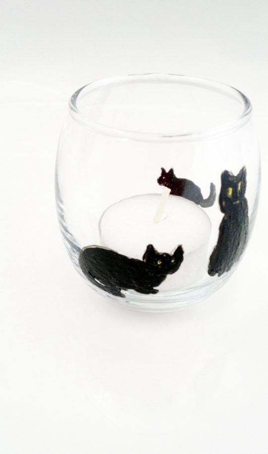 Cat candle holder with three black cats