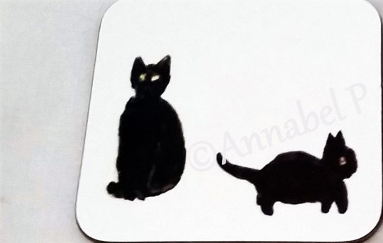 Coaster with two black cats