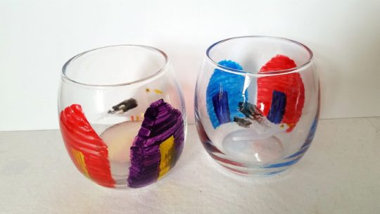 Two tealight holders painted with beach huts and a seagull
