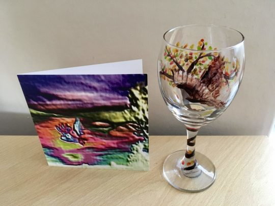 Owl wine glass photographed with an abstract owl card