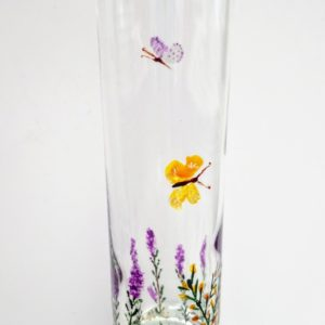 Floral bud vase painted with heather, gorse and two butterflies flying overhead. By Annabel Potter of Animal Glass Designs