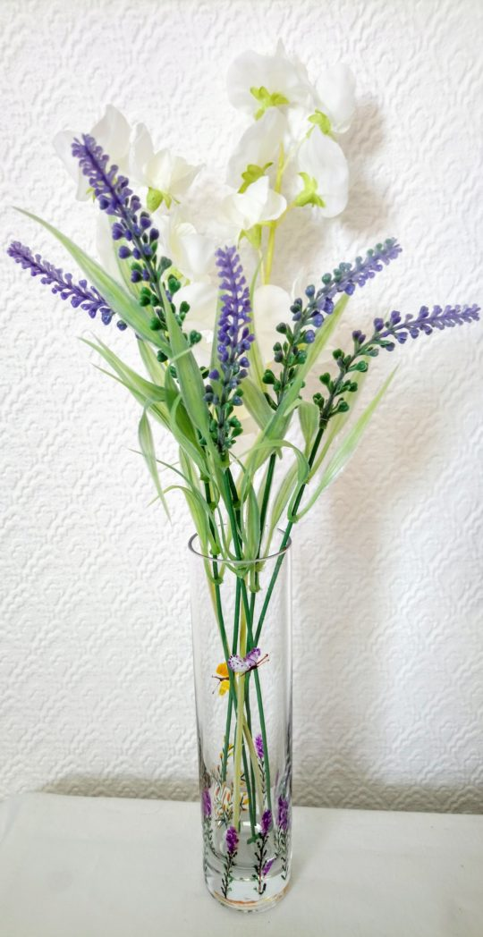Hand painted bud vase with butterfly, heather and gorse. Photographed with flowers