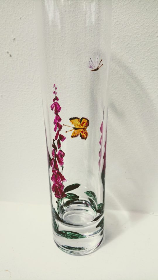 Butterfly Foxgloves glass bud vase photographed from the yellow butterfly side