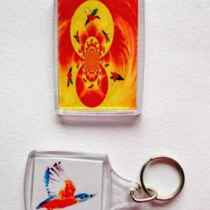 Flying kingfisher artwork on a keyring and fridge magnet