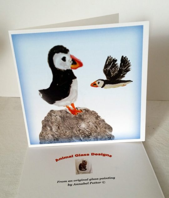 Puffin greeting card with two puffins. One on a rock and another in flight