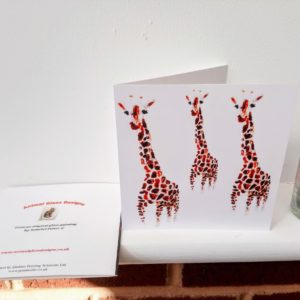 Wildlife greeting ard with three giraffe