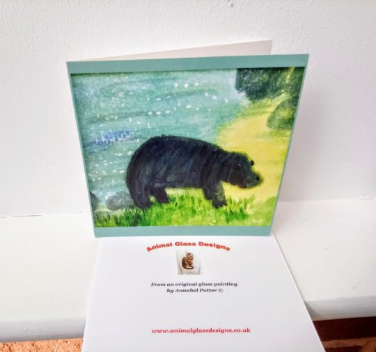 Wildlife art card with a hippopotamus by water.