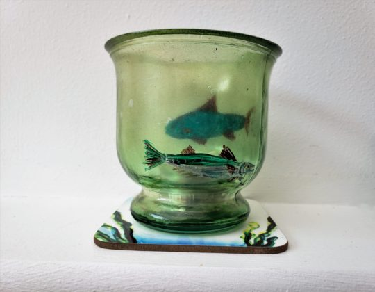 Candle holder painted with two fishes