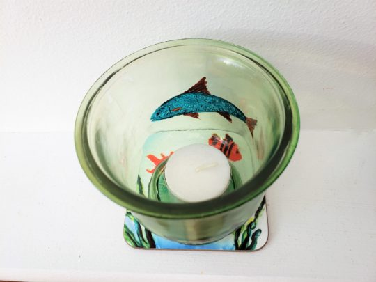 Fish glass candle holder and coaster set photographed from above