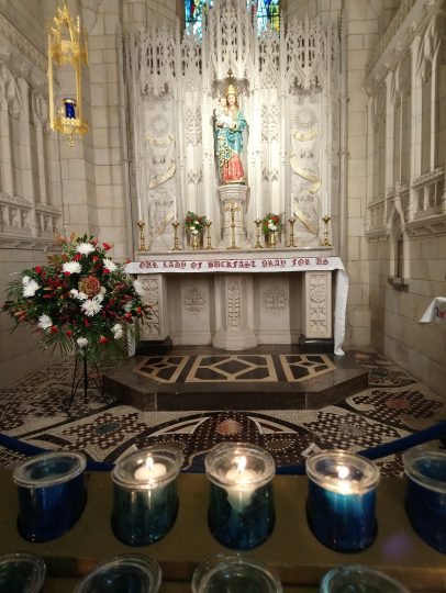 Buckfast Abbey altar with lighted candles in the foreground