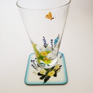 Hand painted glass andmatching coaster with primroses, bluebells and butterfly