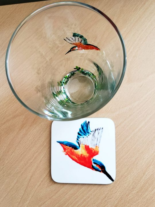Hand painted kingfisher glass with a kingfisher coaster photographed from above