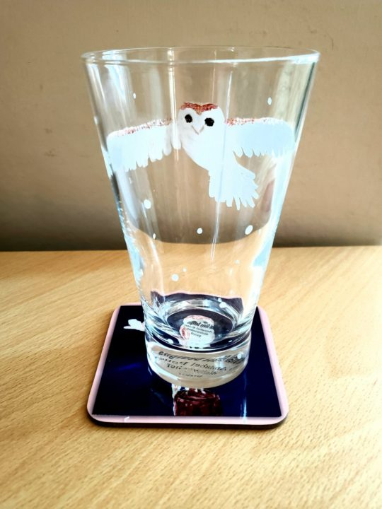 Hand painted glass with a barn owl in flight with a barn owl coaster