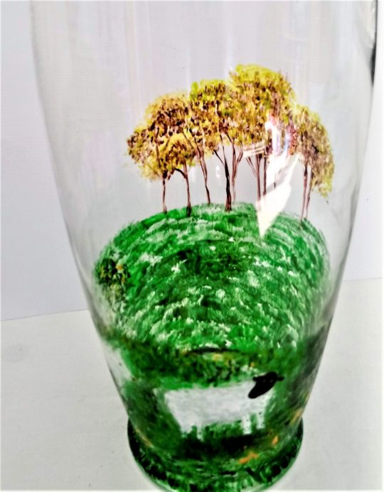 Glass vase with sheep and trees painting