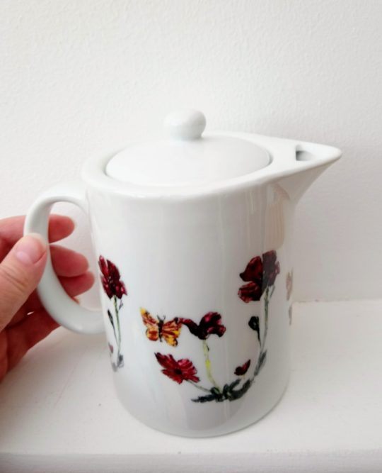 Custom teapots withy animal and floral designs